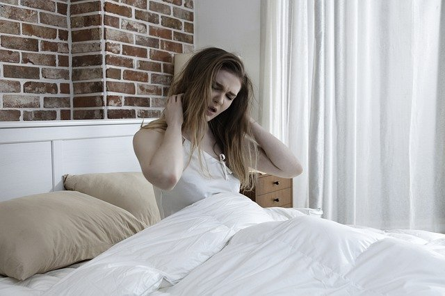 Woman waking up with discomfort