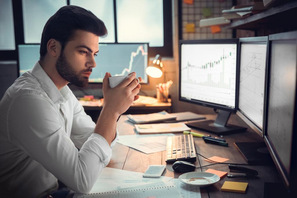 man taking coffee at work
